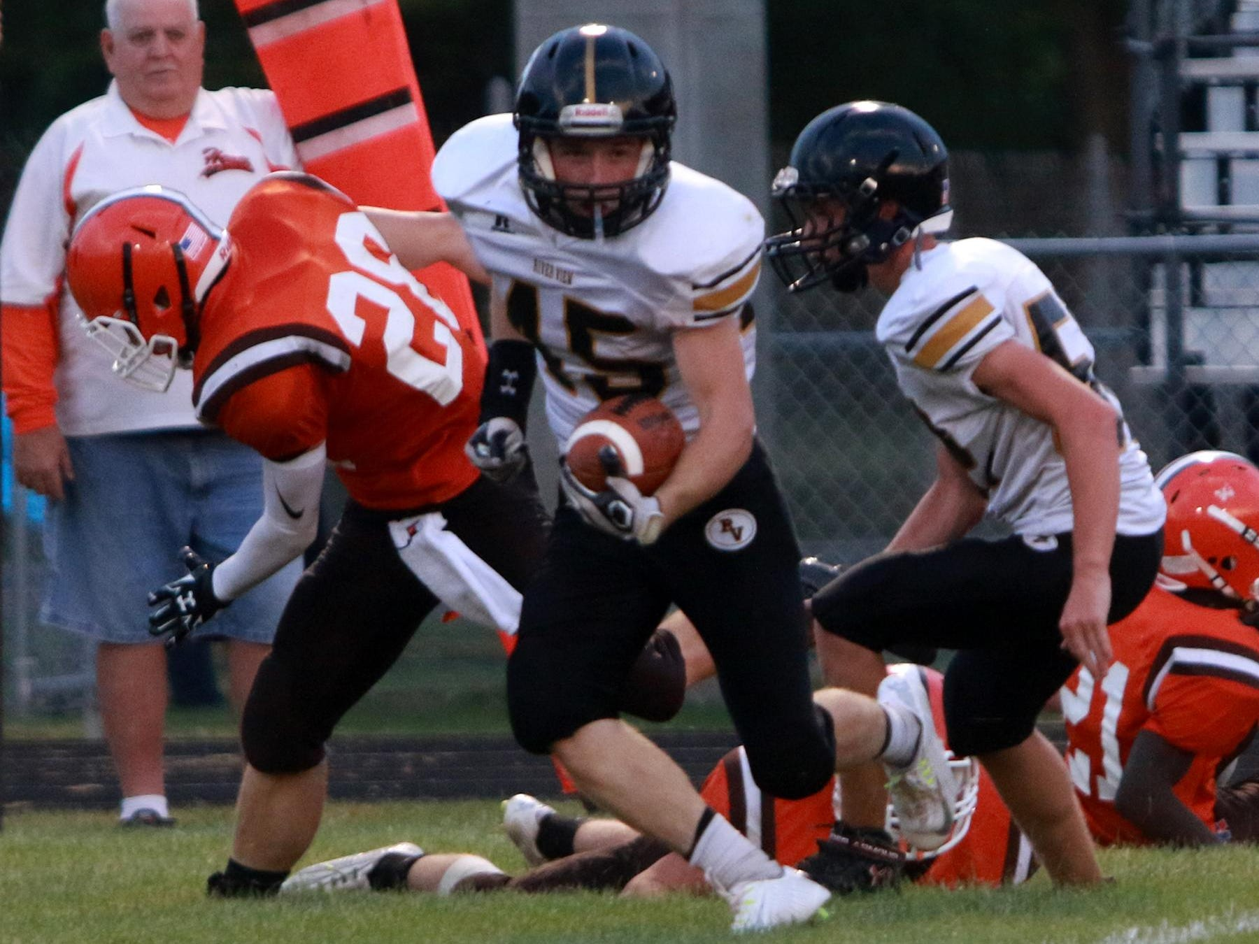 Wide receiver, Cameron Fetzer, runs with the ball in the season open at Heath. The Black Bears lost to the Bulldogs 42-0.