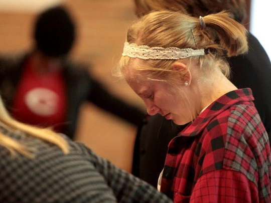 McCala Kreimer prays at Monday's service  for Kelsie Crow, who was her soccer teammate at Purcell Marian.