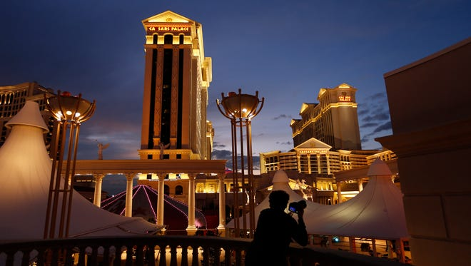 A man takes pictures of Caesars Palace hotel and casino Monday in Las Vegas on Jan. 12.