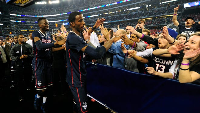 Connecticut's DeAndre Daniels and Amida Brimah celebrate with fans.