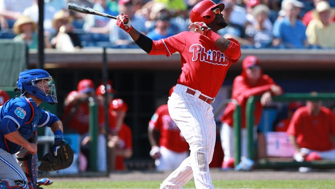 Phillies center fielder Odubel Herrera hits a RBI single during the fifth inning Saturday against the Toronto Blue Jays at Bright House Field.