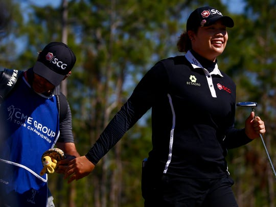 LPGA Tour pro Ariya Jutanugarn smiles on the eighth hole during the final round of the CME Group Tour Championship at Tiburón Golf Club last year. Jutanugarn won, shooting 15 under.
