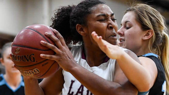 Henderson County's Alisha Owens drives against Muhlenberg's Sheridan Piper in the second quarter as the Henderson County Lady Colonels host Muhlenberg County at Colonel Gym Monday, January 30, 2016.