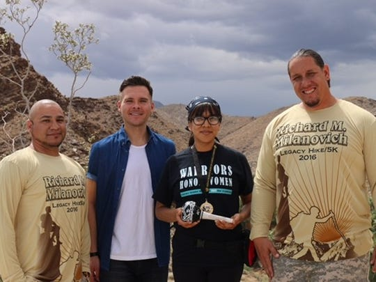 From left, Tribal Council Secretary/Treasurer Vincent Gonzales, Member Reid Milanovich, the recipient of an Agua Caliente educational fellowship, and Chairman Jeff Grubbe.