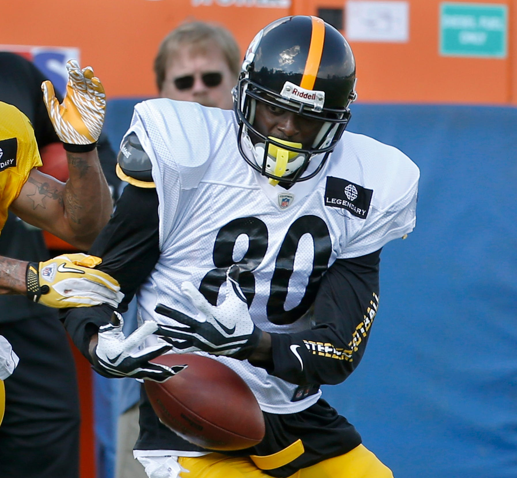 Steelers WR Plaxico Burress (80) has 553 career catches but may not reach 554 after tearing a rotator cuff in camp.