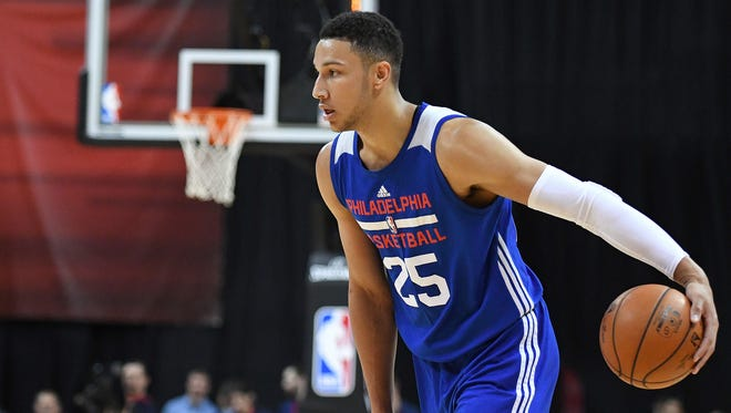 Ben Simmons dribbles the ball during an NBA Summer League game against the Golden State Warriors.