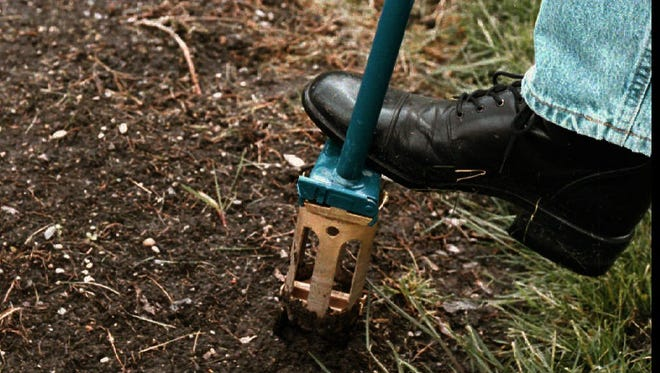 The 5-in-1 Lawn & Garden Tool from Garden Claw featuring a round plug earth-extractor, weeder and edger.