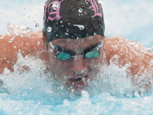 Lincoln Park Academy's Daniel Ochse swims the butterfly leg of the 200-yard medley relay during the St. Lucie County Senior Swimming and Diving Meet at Indian River State College on Wednesday, October 4, 2017, in Fort Pierce.