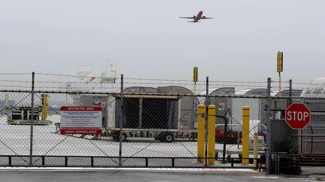 A plane takes off Monday at Mineta San Jose International Airport. A 15-year-old boy scrambled over a fence at the airport, crossed a tarmac and climbed into a jetliner's wheel well, then flew for five freezing hours to Hawaii on Sunday.