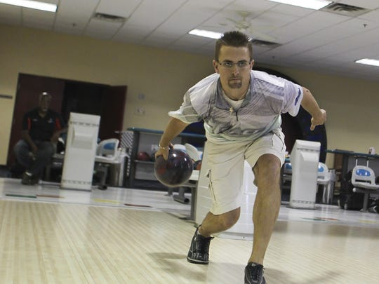 New National Bowling Hall of Fame inductee, David Beck practices at Capital City Lanes.