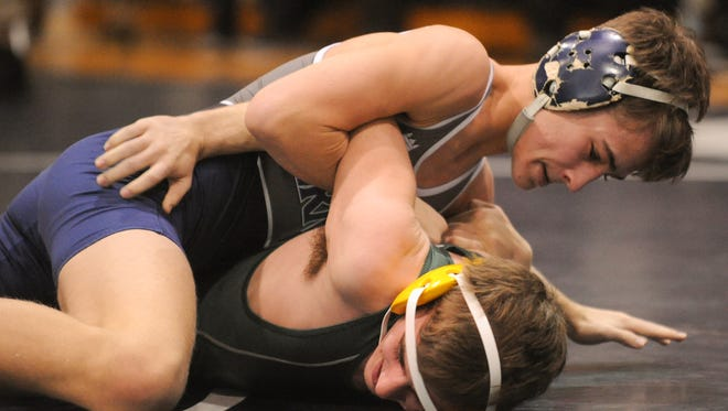St. Augustine's George Coleman, top, pinned Clearview's Max Grosset in the first period of the Hermits' 48-18 win on Saturday morning.