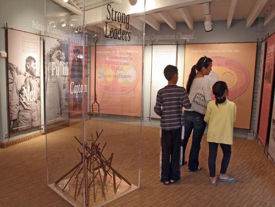 Visitors check out an exhibit at the Agua Caliente