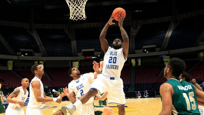Mar 10, 2016; Birmingham, AL, USA; Middle Tennessee Blue Raiders guard Giddy Potts (20) grabs a rebound during the game against Charlotte 49ers  at Legacy Arena.