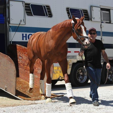 Kentucky Derby favorite Justify is lead off a van...