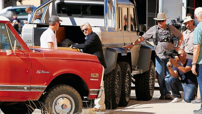 """Actor Michael Douglas, center, is seen during the filming of """"Beyond The Reach"""" on Oct. 1, 2013, on North Behrend Avenue in downtown Farmington. The film's director chose to shoot the project in San Juan County largely because of its landscapes, according to a state film office official."""