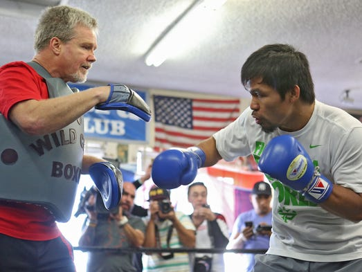 Manny Pacquiao spars with trainer Freddie Roach at Wild Card Gym in Hollywood, Wednesday, April 2, 2014.  He will fight a rematch against Timothy Bradley Jr. April 12th.