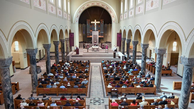 The Cathedral of St. Mary is filled with worshipers for Ash Wednesday services n St. Cloud.