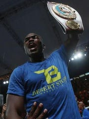 Timothy Bradley holds up the WBO welterweight title following his June 27 win over Jessie Vargas.