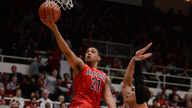 Arizona forward Brandon Ashley (21) drives to the basket past Stanford forward Dwight Powell (33) on Thursday in what may end up as Ashley's final full game of the season.