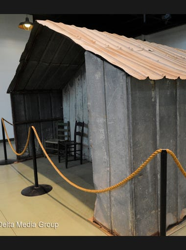 An exhibit featuring a metal cabin from Linnell Camp is on display at The History of Tulare County Farm Labor and Agriculture Museum at Mooney Grove Park.