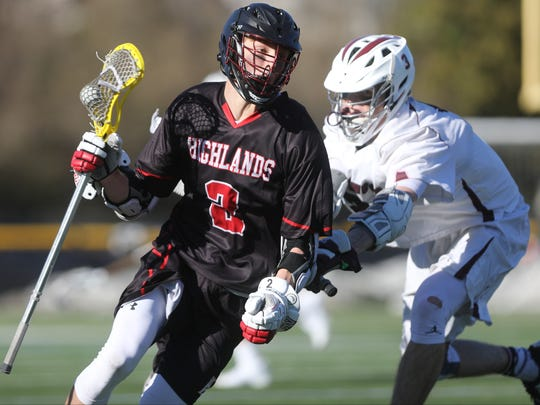 Cooper Richards holds onto the ball for Northern Highlands. Ridgewood went on to beat visiting Northern Highlands, 10-6.  Wednesday, March 29, 2017