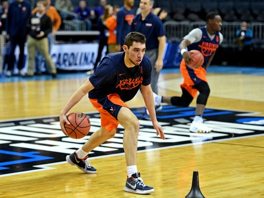 Virginia Cavaliers guard Ty Jerome (11) practices with