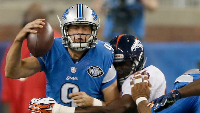 Lions QB Matthew Stafford is sacked by the Broncos' DeMarcus Ware in the first quarter of  Sunday's loss at Ford Field.