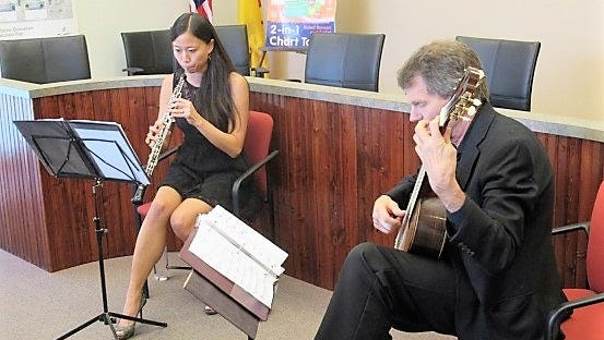 """Emily Tsai on oboe and William Feasley on guitar, performed as """"The Duo D'Amore"""" last week at Carrizozo Village Hall. The program included contemporary music such as Miles Davis, and classical pieces by Handel, Bach and other composers."""