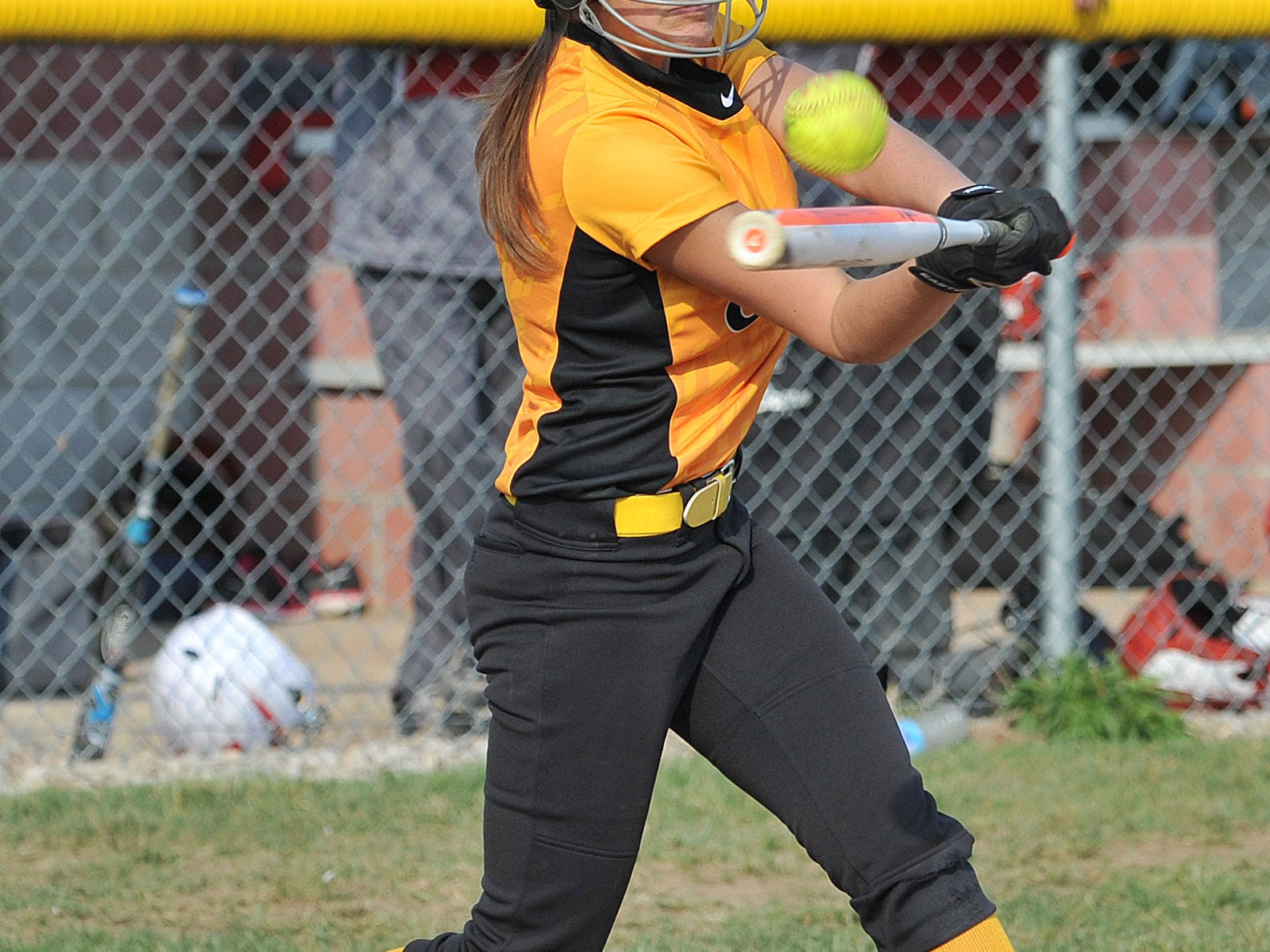 Colonel Crawford's Cassie Sager makes contact with a pitch Wednesday evening during their game against Buckeye Central.