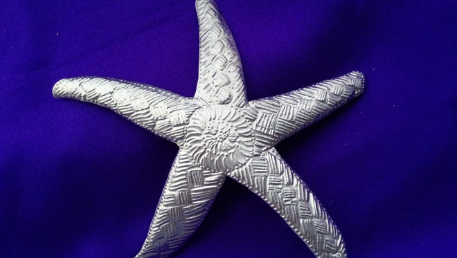 This 2014 image provided by Kauai's Festival of Lights shows a starfish ornament made from a metal can. Heckrodt Wetland Reserve offers children the chance to make and take Christmas gifts Dec. 2.