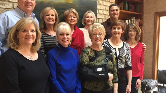 Many people from Country Club Estates helped Rae Reynolds Herbst after a serious fall this November. Herbst nominated all of them as Neighbors Who Care. From left: front, Janet McCarter, Terrill Denton, Rae Reynolds Herbst, Catherine Delevan and Melinda Cardarelli; back row, Patrick Broderick, Lynn Broderick, Judy Reynolds, Betty Douglas and John Cardarelli. Not pictured: Carolyn Norton and Cynthia Wagner.
