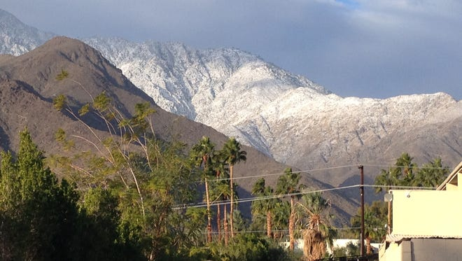 Snow is visible on the San Jacinto Mountains surrounding Palm Springs Wednesday.