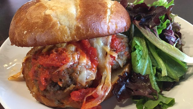 The Juggler sandwich at Mimi Blue holds  three meatballs and a sauce of your choice, plus white cheddar or parmesan cheese, on a pretzel roll. The Dempsey's is the same deal on a baguette.