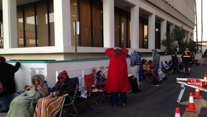 Dozens of people lined up for tickets to see President Barack Obama speak in Phoenix in Jan. 2015.