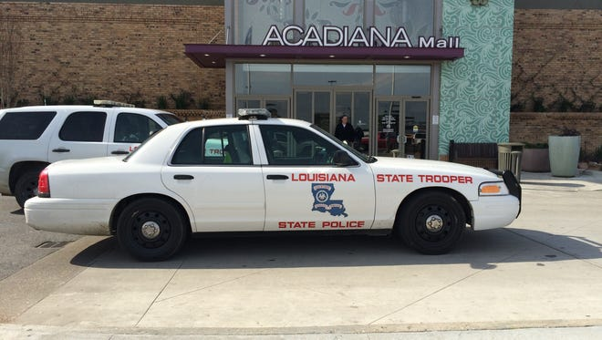 Louisiana State Police investigate a bomb threat at Acadiana Mall Saturday. The building has been evacuated.