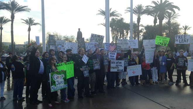 Protesters displayed signs calling for marijuana legalization for various reasons.