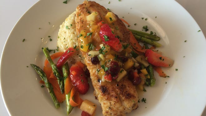 The Tropical Grouper features a mango-berry salsa at Blue Seafood.