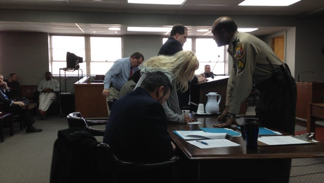 Laura Morris signs papers in Humboldt General Sessions Court Wednesday.