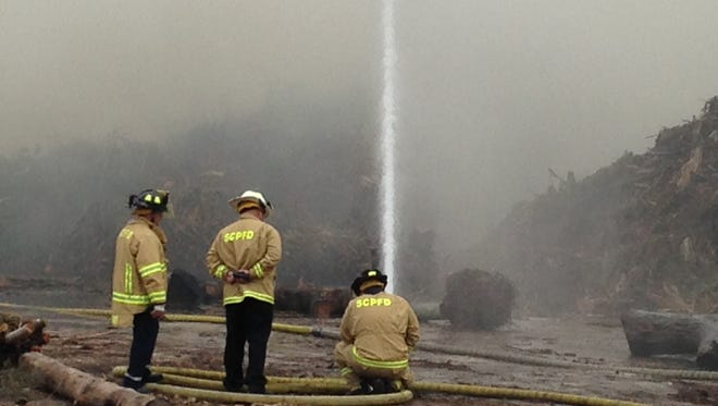 Firefighters are working a mulch fire off Michael G. Rippe Parkway