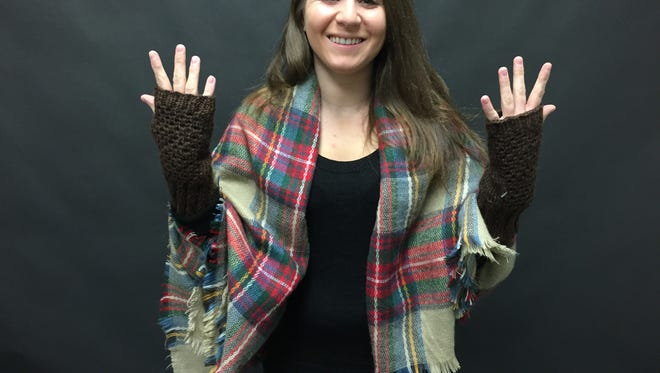 Here's Jenna with her new mitts. Do you think she's delighted? You bet!