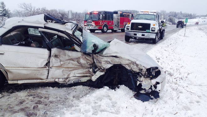 A wrecker arrives Monday morning to remove the crushed sedan driven by Pearl Farley, 78, of Colchester, on Vermont 289. Farley died in the accident, as did the driver of the other vehicle, Neil McKee, 55, of Cambridge.