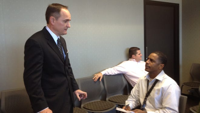 Steven Picou, left, new airport director, speaks with Chris Clark, air traffic manager.