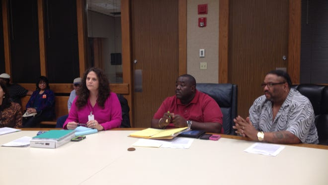 Councilman Kenneth Boudreaux, center, is proposing a ban on smoking in Lafayette bars.