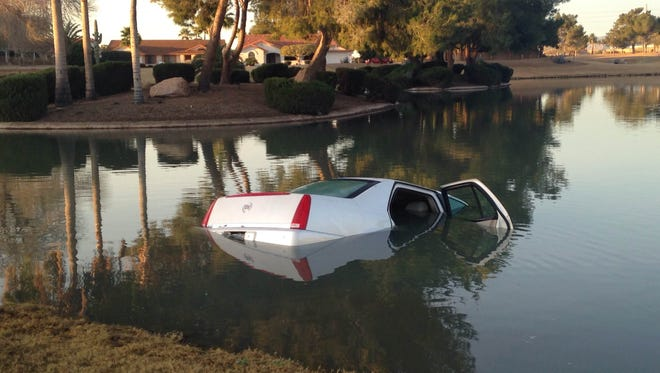 Crews pulled a Cadillac out of a small Sun City West lake on Jan. 28, 2015.