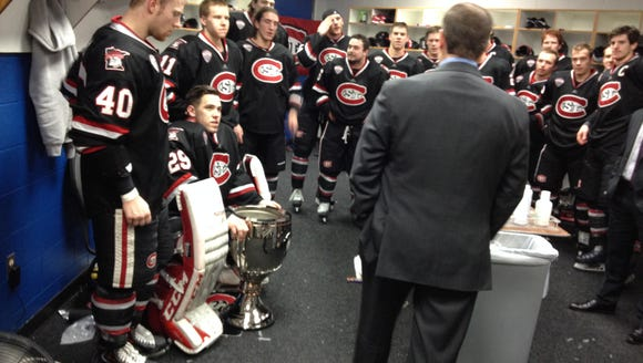St. Cloud State players listen to the NCHC's Don Adam