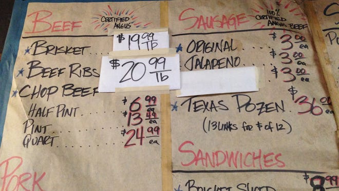 The wall menu at Louis Mueller Barbecue in Taylor, Texas, reflects price changes due to the spiraling price of Texas beef.