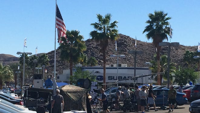 A commercial is filmed at the Volkswagen dealership in Cathedral City.
