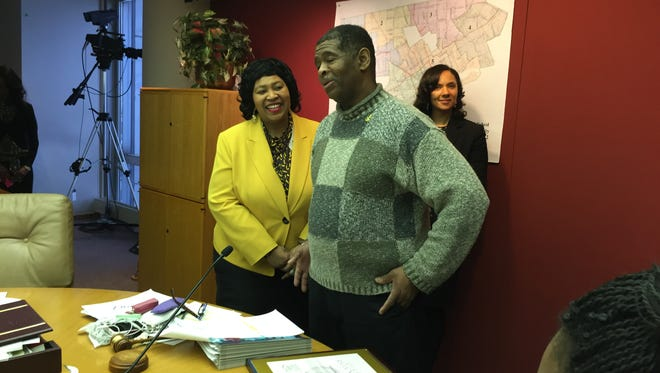 Detroit City Council President Brenda Jones, left, listens as James Robertson accepts the Spirit of Detroit Award Tuesday, Feb. 27, 2015. Councilwoman Mary Sheffield, right, represents the 5th District where Robertson lives.