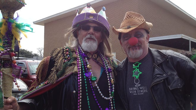 """Krewe of Cous Cous King Ralph Schexnayre, left, poses with his """"attorney."""""""