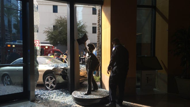 A car crashed through the Republic Media building in downtown Phoenix on Feb. 19, 2015.